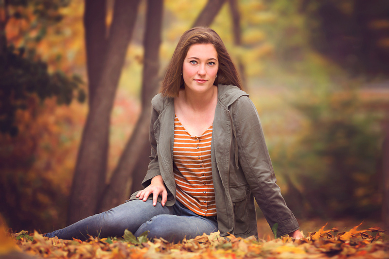 Senior high girl outside in the woods for her pictures by Melissa Collins Photography