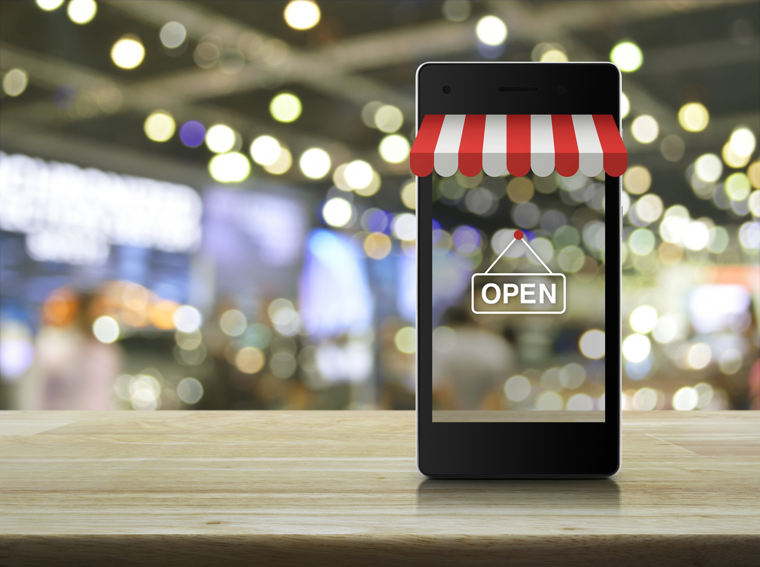 Modern smart mobile phone with on line shopping store graphic an open sign personal brand photography with MJCollins