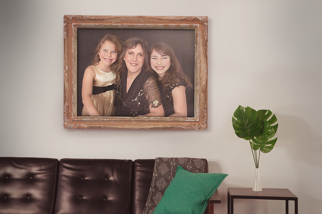 Grandma and grandchildren in a beautiful frame hung over the couch
