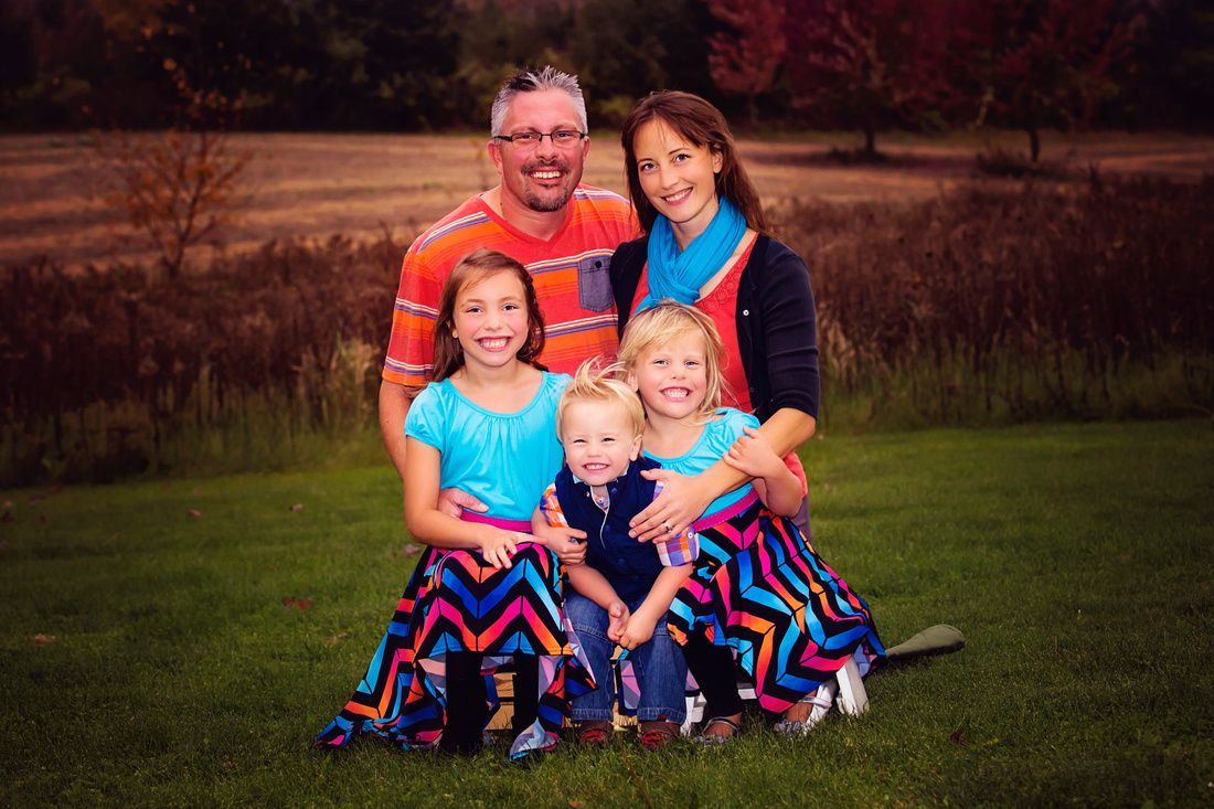 Family in colorful coordinating outfits